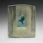 Porcelain plate, various copper glazes, oxidisation gas fired. 21cm x 18cm (BM153)