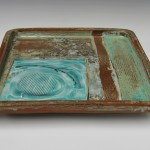 Large square stoneware tray with porcelain slip and copper glazes.