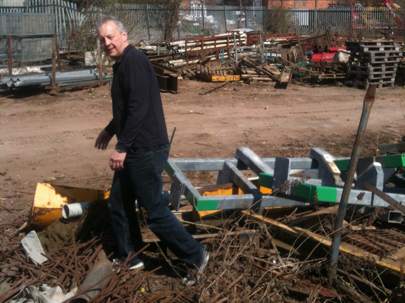 Ian searching scrapyard for hinges