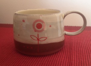 Slip decorated mug by Michaela Grimshaw